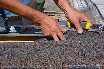 Contractor Repairs Roof
