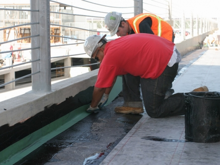 Workers Waterproofing Roof - Portland, OR - McDonald & Wetle